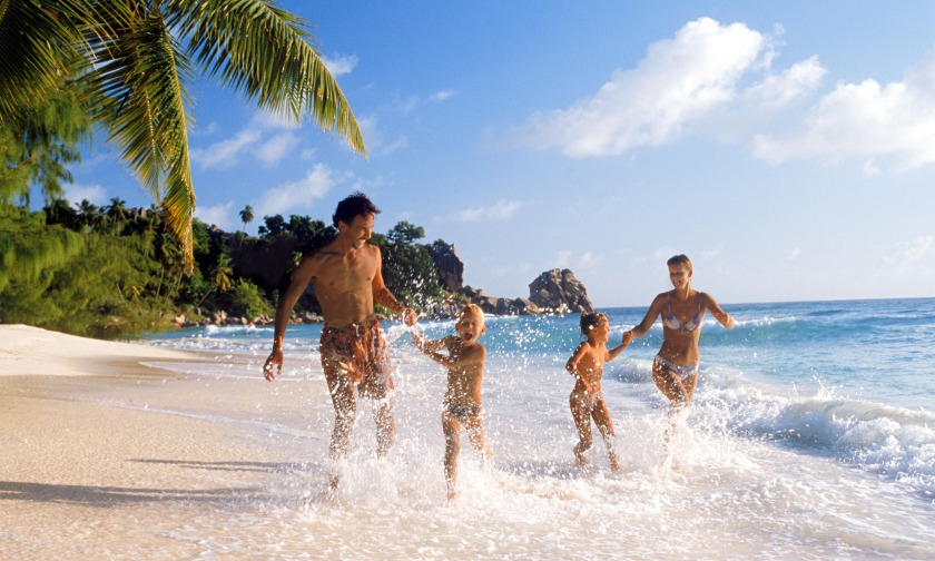 A family on holiday in the Seychelles.